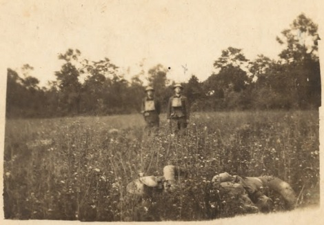 Dunham & Smith, with unidentified dead Marines. Taken sometime shortly after June 6.