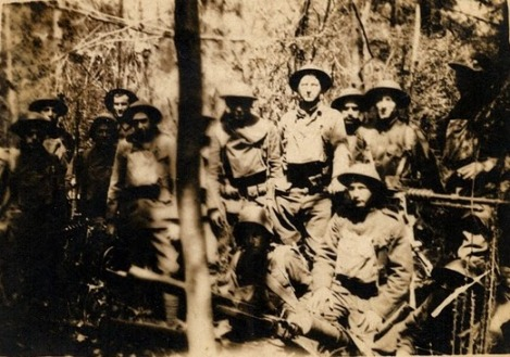 "Frank Dunham's caption for this photo reads: ""The crack Machine Gun Section of the world, after 28 days in Belleau Woods"". Individual Marines remain unidentified."